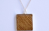 <p>small wood and resin necklace $59</p>