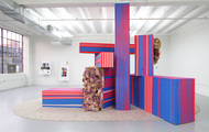 """<p><em>Happy House&nbsp;</em></p> <p class=""""p1"""">Flourescent Grenadine and painters tape on questionably built boxes; coffee and whiskey stained cloth wrapped in popped balloons, Band-Aids, a little bit of paint and some resin; carpet.<span class=""""Apple-converted-space""""><br /></span></p> <p class=""""p1"""">&nbsp;</p>"""